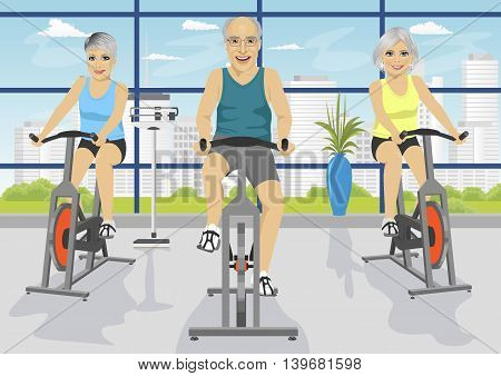Senior people working out at the fitness center on exercise bikes