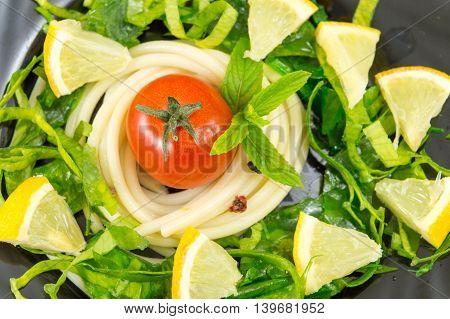 Spaghetti Around Small Tomato With Spices