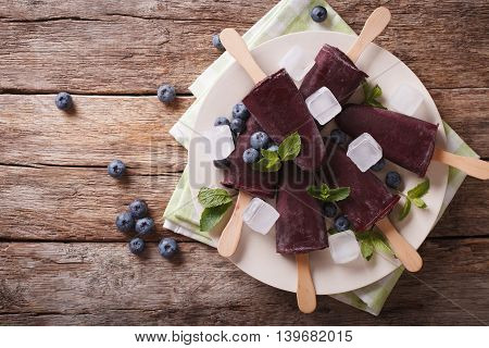 Blueberry Ice Cream On A Stick Close-up. Horizontal Top View