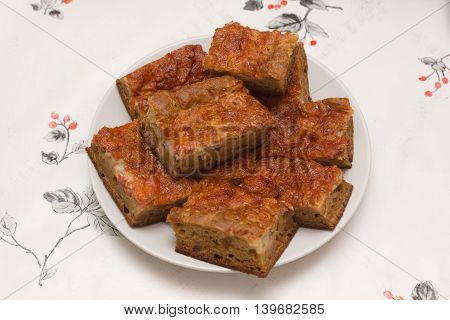 meat pie cut into large pieces and put on a plate