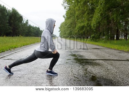 Running Stretching In The Rain.