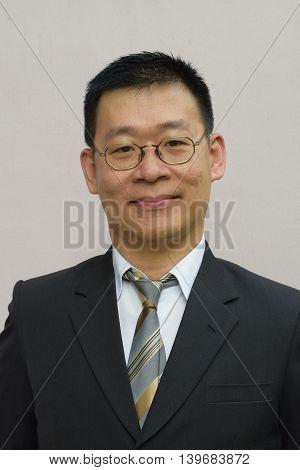 Portrait of a smiling asian business man