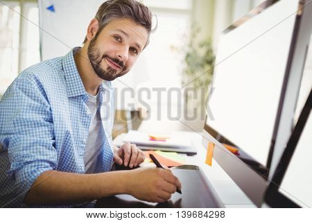 Portrait of young businessman working in creative office