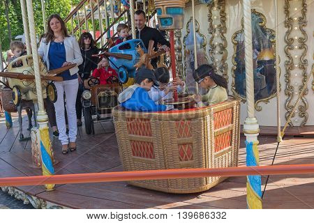 Kiev Ukraine - May 01 2016: Parents and children ride on the carousel at St. Michael's Square