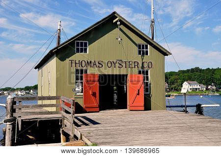 Mystic Connecticut - July 11 2015: 1874 Thomas Oyster Co. at Mystic Seaport was originally from New Haven Connecticut