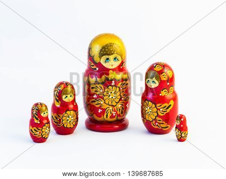 Five Traditional Russian Matryoshka Dolls On White Background