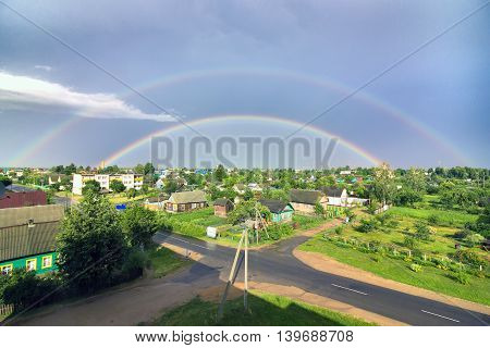 Double rainbow over the city after the rain