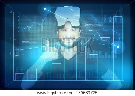 Young man in VR-headset on his head is showing thumbs up sign while using forward technology touch screen monitor over dark blue background