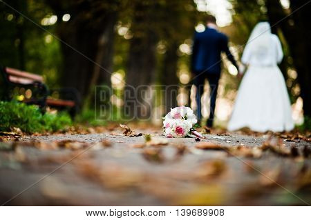 Wedding Bouquet On The Pavement Background Newlyweds