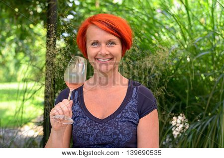 Pretty Redhead Woman Drinking A Glass Of Champagne