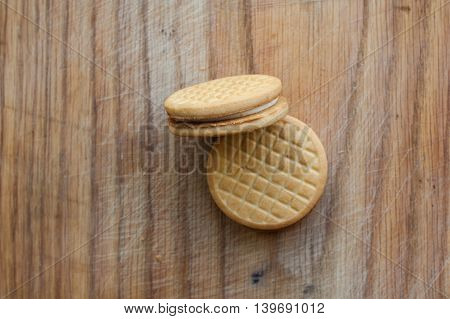 Several pieces of round cookies on a wooden background.