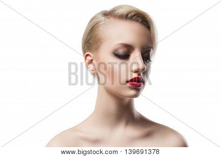 Portrait of attractive young woman with make up and hairstyle looking down.Isolate.White background