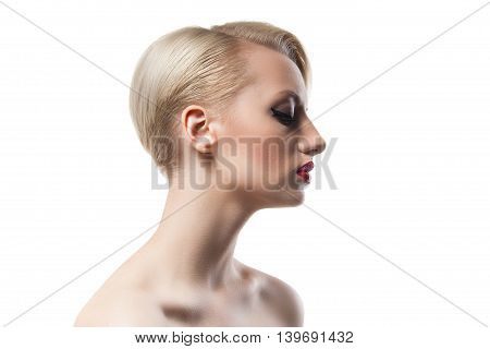 Side view of short-haired blonde girl with red lips and bare shoulders on white background.Isolate