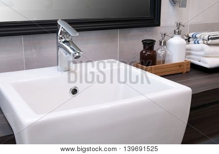 Faucets and sinks Ceramic White. On a wooden table top