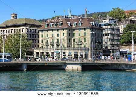 Zurich, Switzerland - 20 July, 2016: view on Bahnhofbruecke bridge and Central square across the Limmat river. Zurich is the largest city in Switzerland and the capital of the Swiss canton of Zurich.