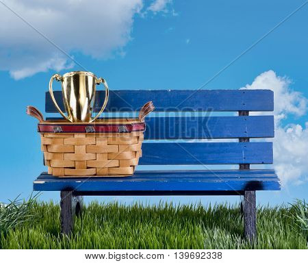 Blue park bench with handmade basket and trophy.