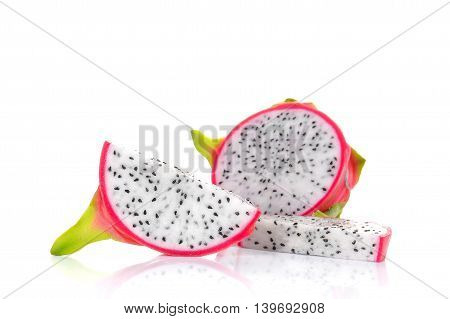 Fresh dragon fruit cut pieces on white background.