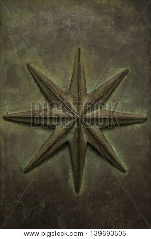 The star on old copper Holy Door ( Porta Sancta) Archbasilica of St. John Lateran in Rom.