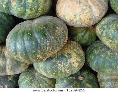 Pumpkins on the market of India closeup
