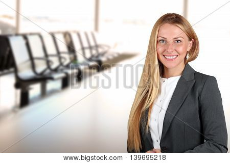 The Beautiful smiling business woman portrait. Office
