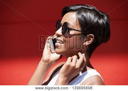 Headshot Of Beautiful Stylish Young Woman With Short Pixie Hairstyle Wearing Round Shades Making Pho