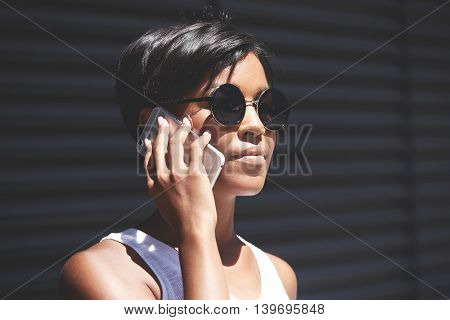 Worried Black Female With Short Haircut Wearing Round Shades Calling Her Boyfriend On Cell Phone Try