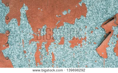 Rustic weathered paint on zinc metal background texture