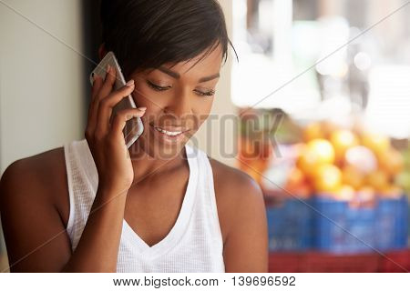People And Technology Concept. Young African Female Student With Short Black Haircut Making Phone Ca