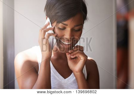 Close Up Portrait Of Beautiful Dark Skinned Woman With Healthy Skin Talking On Cell Phone With Her M