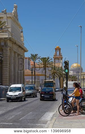 People On Bicycles Waiting For Crossing The Road In Cadiz, Spain