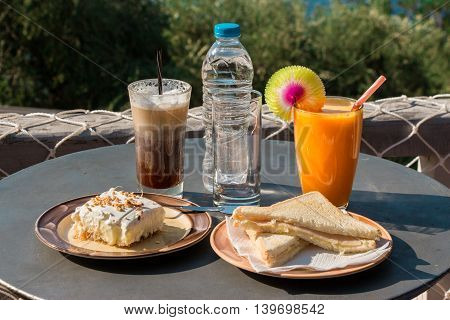 Coffee, orange juice, cheese ham toast, ekmek dessert, water for breakfast
