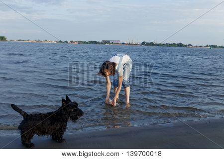 brunette travels on the beach true friend