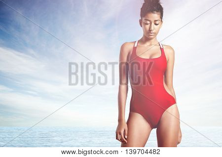 Woman Wears Red Swimsuit Like A Life Guard On A Beach
