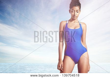 Young Woman On A Beach, Wears Swimsuit