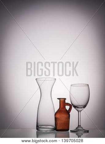 Glasses And Bottle In Blue Color Tone.