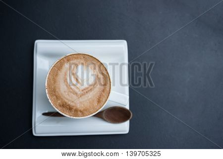 hot fresh coffee in white cup on black table and white saucer cappuccino coffee mocha coffee espresso coffee latte coffee