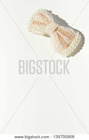 Bow Pearl, on white backgrounds, vintage style