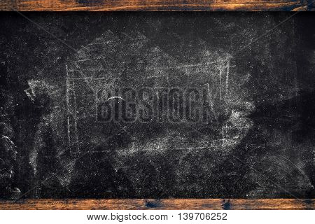 Chalk marks on dirty used vintage school blackboard with wooden frame education message copy space