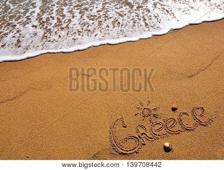 The  Greece sign on the sand beach