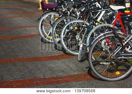 Group of parked city bikes on a street with perspective view