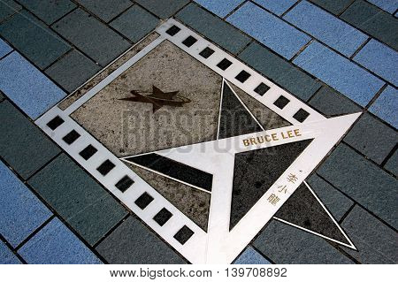 Hong Kong China - December 15 2005: Legendary Kung Fu movie star Bruce Lee's star on the Avenue of the Stars promenadein Kowloon