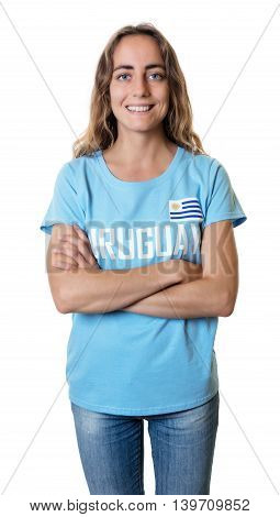 Female sports fan from Uruguay with crossed arms on an isolated white background for cut out