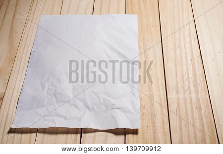 White blank paper on wooden texture background low key tone