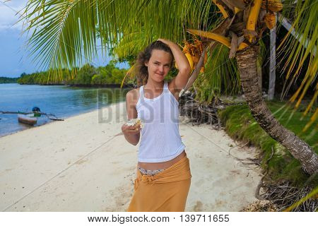 Photo young girl relaxing on beach with flowers. Smiling woman spending chill time outdoor Bali island. Summer Season Caribbean Ocean. Horizontal picture