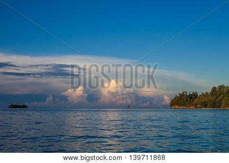 Panoramic View Bungalow in Indonesia Village Tropical Beach in Bali Island Sunrise. Summer Season Caribbean ocean. Horizontal Picture