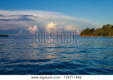Panoramic View Bungalow in Indonesia Village Tropical Beach in Bali Island Sunset. Summer Season Caribbean ocean. Horizontal Picture
