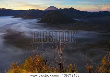 Sunrise Mountains.Asia Nature Morning Volcano Viewpoint.Mountain Trekking, Valley View Landscape . Nobody photo. Horizontal picture. The first rays of the rising sun