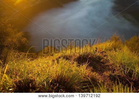 Sunrise Mountains.Asia Nature Morning Volcano Viewpoint.Mountain Trekking, Valley View Landscape . Nobody photo. Horizontal picture. The first rays of the rising sun. High Texture Detalled Image