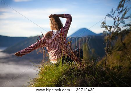 Portrait Young Pretty Girl Sunrise Landscape.Africa Nature Morning Volcano Viewpoint.Woman Engaged Yoga Meditation Mountains Dawn.Mountain Trekking.Horizontal picture.First Rays Rising Sun
