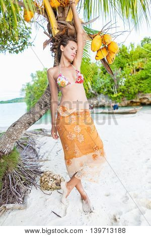 Smiling Woman Spending Chill Time Outdoor Bali Tropical Island. Exotics Summer Season Caribbean Ocean. Exotic Fruits Palm Fish Boat. Vertical Picture. Blurred background